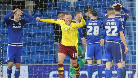 Matt Connolly (left) holds his head after scoring Burnley's equaliser