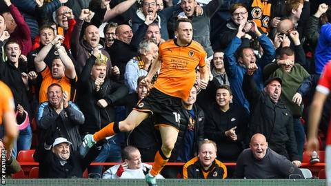Diogo Jota celebrates the first of his two goal for Wolves against Forest at the City Ground