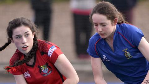 Orla Thompson, who scored a hat-trick for Banbridge, pictured in action against Ursuline's Izzy Walsh