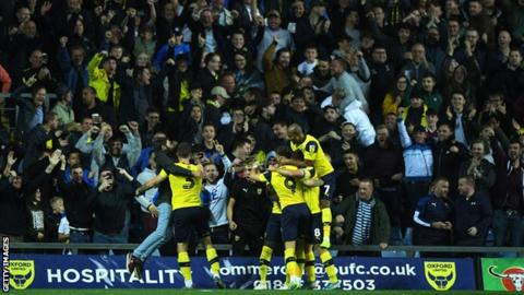 Oxford United fans celebrate their second goal against West Ham