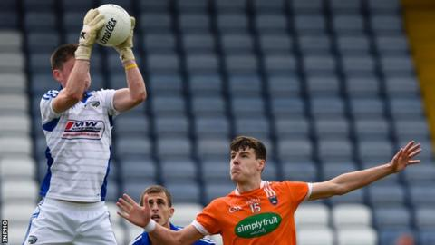 Laois goalkeeper Graham Brody makes a high catch above Armagh's Niall Grimley