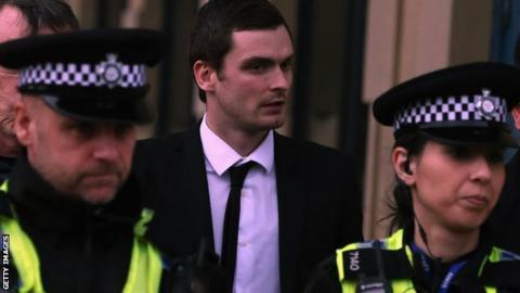 Adam Johnson leaving court during his trial