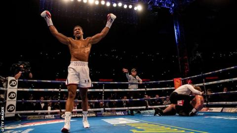 Anthony Joshua celebrates beating Alexander Povetkin