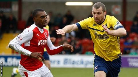 Scunthorpe's Stephen Dawson (yellow) in action at Fleetwood
