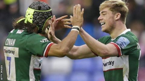 London Irish players celebrate a try