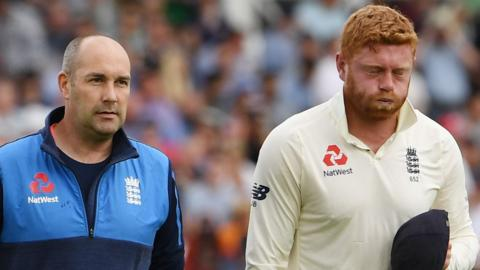 Jonny Bairstow leaves the field with an injured hand