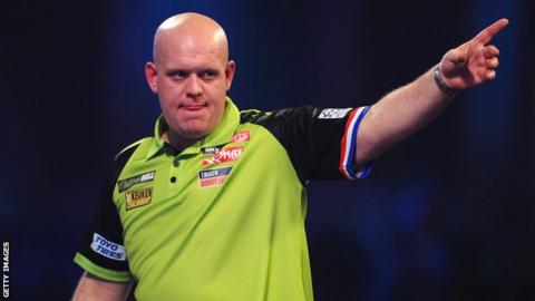 Defending champion Michael van Gerwen points in celebration during his quarter-final victory over Darius Labanauskas in the PDC World Championship