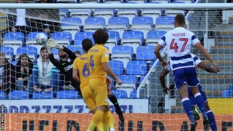 Preston's Declan Rudd saves a shot