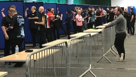 Fallon Sherrock poses for a photo during a break in practice at darts Q School