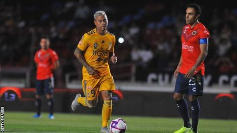 Veracruz player Leobardo Lopez (right) watches Eduardo Vargas of Tigres
