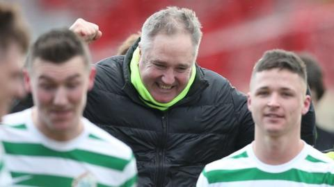 Lurgan Celtic manager Colin Malone (centre) celebrates after his team's Irish Cup victory over Portadown