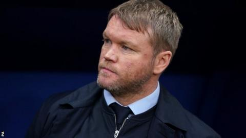 Grant McCann watches on