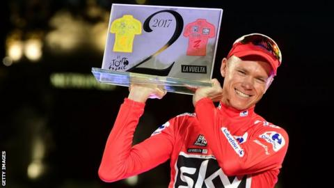Chris Froome holds up a trophy to celebrate winning the Tour de France and Vuelta a Espana in 2017