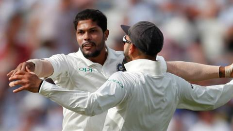 Umesh Yadav celebrates taking a wicket with India captain Virat Kohli
