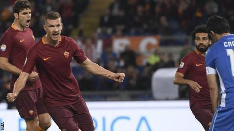 Edin Dzeko celebrates scoring for Roma against Empoli