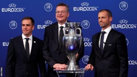 Germany bid ambassador Philipp Lahm (left), German FA president Reinhard Grindel and Uefa president Aleksander Ceferin