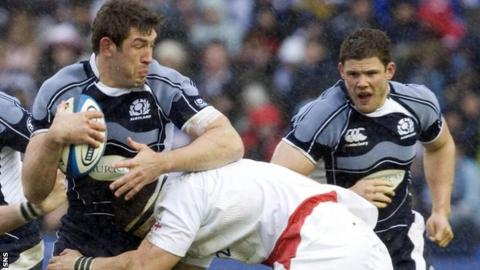 Scotland's Nathan Hines is tackled against England in 2008, as Ross Ford looks on