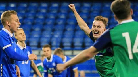 Mark Sykes celebrates scoring to put Northern Ireland 3-2 in front against Estonia