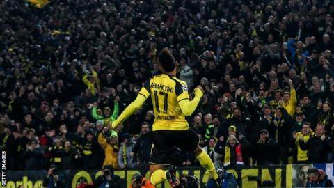 Pierre-Emerick Aubameyang jumps to celebrate after scoring