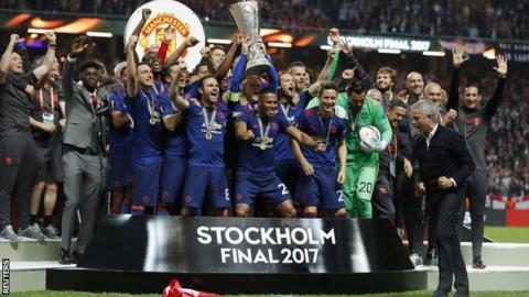 Manchester United lift the Europa League trophy
