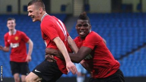 Luke Giverin celebrates scoring with Paul Pogba
