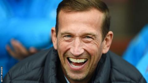 Justin Edinburgh on the sidelines
