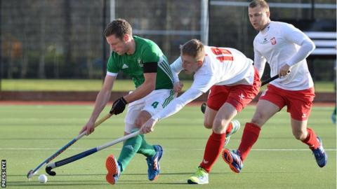 Ireland's Jonathan Bell comes under pressure from Polish pair Jack Kurowski and Patrick Bulka