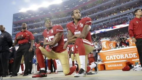 Eric Reid (left) and Colin Kaepernick kneel during the national anthem