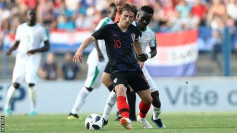 b9d54bcdb Croatia s Luka Modric battles with Senegal s Idrissa Gueye