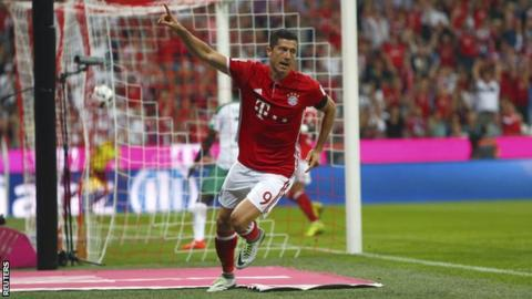 Bayern Munich forward Robert Lewandowski celebrates scoring against Werder Bremen