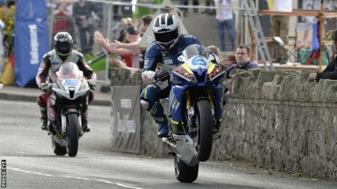 William Dunlop pulls a celebration wheelie after winning Friday night's race at Armoy