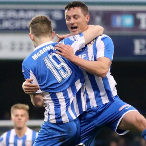 Goal scorer Jamie McGonigle celebrates with team-mate Ruairi Harkin after scoring in Coleraine's 2-1 win over Ballymena United