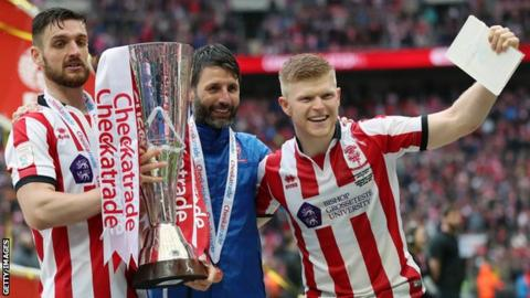 Lincoln City celebrate winning the EFL Trophy last season
