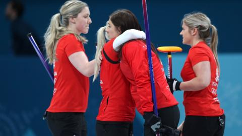 GB curlers console each other
