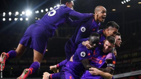 Liverpool players celebrate James Milner's goal at Arsenal