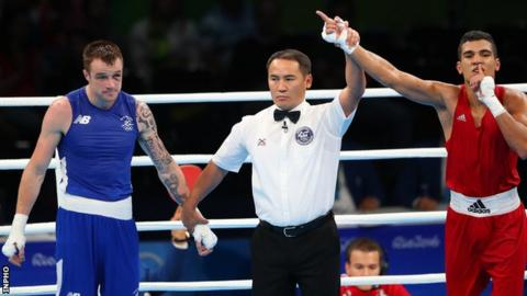 Mohammed Rabii is declared the winner of the welterweight quarter-final