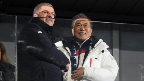 South Korea president, Moon Jae-in (right) and Olympic president Thomas Bach greet the stadium