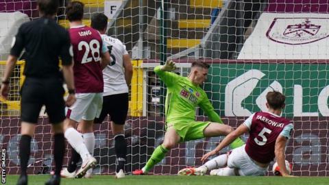 James Tarkowski slides in to score for Burnley against Sheffield United