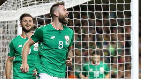 Daryl Murphy (right) celebrates his second goal in Friday's game as team-mate Shane Long also shows his delight