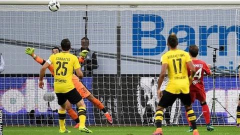 Admir Mehmedi (right) scores for Bayer Leverkusen against Borussia Dortmund