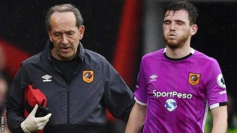 Hull City left-back Andrew Robertson is led off against Bournemouth