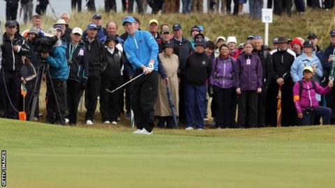 Gavin Moynihan plays an approach during the morning foursomes