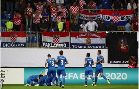 Azerbaijan players celebrate