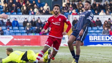 Aberdeen defender Shay Logan celebrates after scoring against Ross County