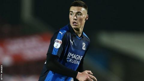Lloyd Jones in action for Swindon Town against Northampton