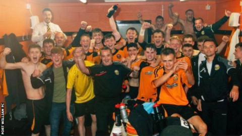 Fort William FC celebrating win in dressing room