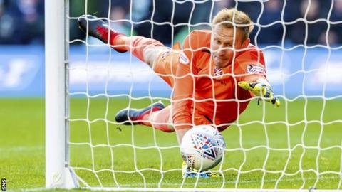 Hearts goalkeeper Zdenek Zlamal scrambles the ball off the line