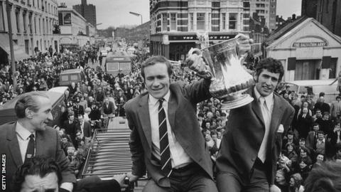 Chelsea players Ron Harris (left) and Peter Bonetti hold the trophy aloft.