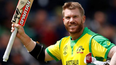 David Warner raises his bat