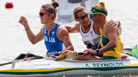 Dickins (centre) with fellow para-canoeists after the KL3 200m single final at the Rio Paralympics